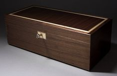 Walnut Jewellery Box with concealed drawers.