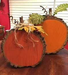 Painted tree sections and embellished with leaves... Pumpkins!