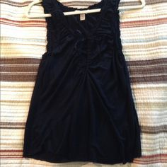 Free people tank top Darling jersey tank with cute ribbon tie in front. Raw hem and either black or super dark navy. In excellent condition. Free People Tops Tank Tops