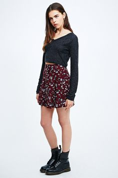 PINS & NEEDLES FLORAL BUTTON-THROUGH FLIPPY SKIRT IN MAROON £35.00  SKU # 5120466616775 This flippy skirt has been created by Urban Outfitters exclusive label Pins & Needles with an all-over ditsy floral print for a playful edge.  THINGS TO KNOW: - Composition: 100% Viscose  - Elasticated waistband  - Care: Machine wash