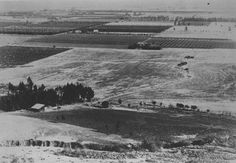 1895 photo over Villa Park. The dirt roads in the photo are what would be Lincoln, Nohl Ranch Rd, Santiago/Wanda, and Meats. Photo is looking West.