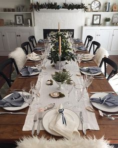 Want to branch out from traditional red and green but still keep your table feeling festive? Try styling your tablescape in icy blue, white, and silver instead. Finish the look with live greenery and sheepskin-draped dining chairs for a cozy wintry feel.