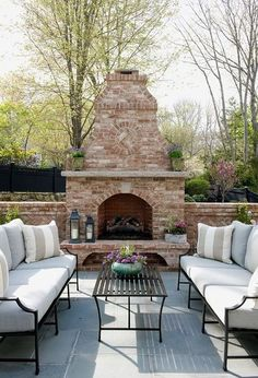Traditional paver patio with fire pit and planting area. Via Pavestone   Looking for some patio inspiration this spring?  We have found ...