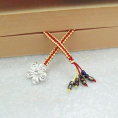 Macrame Bookmark with silver plated flower charm