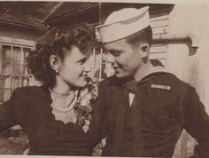 Mobile's Maurice Bell, in blue Navy uniform, and his bride Lois K. Richards on their wedding day in Nineveh, Indiana, October 29, 1944. Aboard the USS Indianapolis, Bell witnessed the battles of Tarawa, Saipan and the Philippine Sea.
