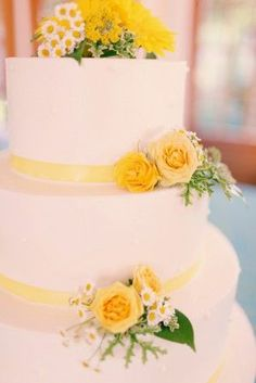 Three Tier yellow ribbon with fresh yellow flowers