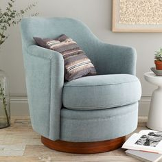 The Tub Swivel Armchair features a smooth rounded profile and a wood plinth base that hides its swivel mechanism. Cute and compact, it's a smart update to a classic design.