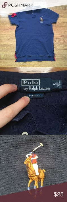 Polo by Ralph Lauren Big Pony Polo Perfectly broken in big pony polo by Polo By Ralph Lauren. Embroidered big pony, number 4 on the right sleeve, navy blue polo. The size is small but it is an oversized, slouchier fit, fits a medium. Any light areas you see on the fabric in the photos are not stains, it's how the fabric reacts to being touched and goes away. Pre loved and in great condition. Polo by Ralph Lauren Tops Tees - Short Sleeve
