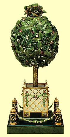 The Bay Tree Fabergé egg is a jeweled carved enameled Easter egg made in 1911 for Nicholas II of Russia, who presented the egg to his mother, the Dowager Empress Maria Feodorovna on April 12, 1911. Turning a tiny lever disguised as a fruit, hidden among the leaves of the bay tree, activates the hinged circular top of the tree and a feathered songbird rises and flaps its wings, turns its head, opens its beak and sings