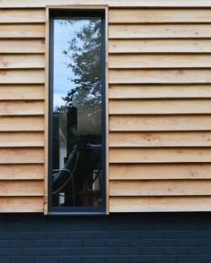 Modern timber cladding & navy bricks ~ designed by Snug Architects