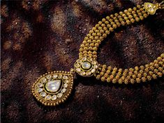 Indian Jewellery and Clothing: Short and cute gold necklace..