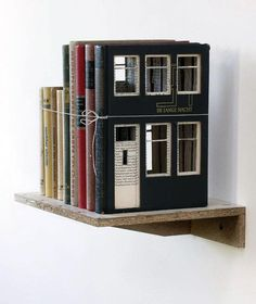 """Frank Halmans (Dutch) """"Built of Books"""". Binding a few unexceptional old books together at one time, he would then proceed to carve doors, windows and other architectural elements into them. Considering that many people will be against the idea of destroying books, even if it is for the sake of art, Halmans takes care to select only books whose alternative fate lies in idle storage in forgotten corners."""