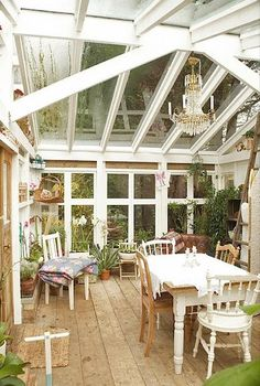 dining in the greenhouse.   I can find lots of reasons not to use the greenhouse as living space, but the look still really appeals to me.