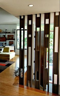 Want to divide the living room into several parts? The most perfect solution is to use the living room partition. By using partitions, you can partition the room but not permanently because it can … Living Room Partition Design, Living Room Divider, Room Partition Designs, Partition Ideas, Wooden Partition Design, Divider Design, Wall Design, House Design, Divider Ideas