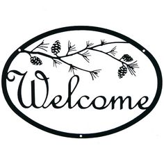 """Handmade Script Iron Welcome Sign: Pine Branch. What a wonderful way to welcome friends and family to your door while adding a touch of charm to the outside of your home! Measuring 12"""" x 9"""" with script lettering and a pine branch accent, this sign is created from iron and powder-coated to allow a lifetime of protection from the elements. Easy to install on most surfaces with two screws (included). Handcrafted in upstate New York. This sign is perfect for homes with an outdoor charm!"""