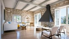 I like the stone, beams & french doors basically everything except the furniture & that hideous black chimney