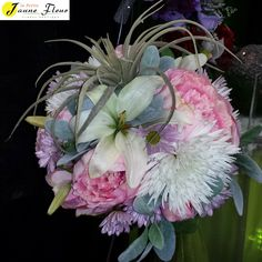 Pink Peonies is the focus of this bouquet. Add a special twist of a succulent and this is a great bouquet for the modern bride who thinks outside the box.