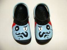 Beautiful pair of boy sandals/clogs    From: Crocs    Size: 12-13      Color: Blue/Black/Red