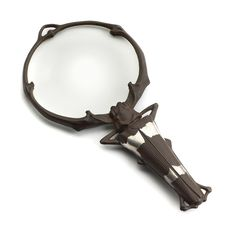 Art Nouveau Magnifying Glass by Lucien Gaillard - made of iron, the body in the form of a stag beetle with characteristic silver bands, the long horns encircling the glass lens. Lucien Gaillard Paris, circa 1900. 208 mm in length, 100 mm across the lens.