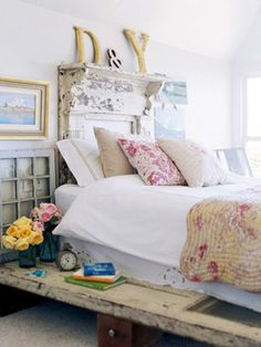 vintage touches ...using an old mantle for a headboard, as well as the old windows and door used as decor and furniture.