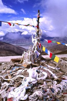 Prayer Flags at the top of a mountain pass outside of Lhasa, Tibet  ©Steve Gillick