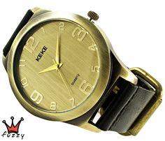 Ανδρικό ρολόι  σε μπρονζέ χρώμα. Λουράκι δερμάτινο σε μαύρο. Καντράν 44 mm.