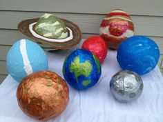 Paper mache Solar System. Supplies: •balloons •old magazines or newspapers •flour •water •salt •large bowl or tray •whisk or large spoon •string •acrylic paint, assorted colors •paint brush •poster-board