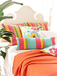striped pillow - 2 shades of aqua, 2 corals, an orangy yellow and a green