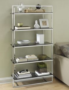 Display your collectibles in style with the fashionable Manhattan Bookcase. This elegant piece of contemporary furniture features five tempered glass shelves. Wine Glass Shelf, Glass Shelves In Bathroom, Floating Glass Shelves, Bathroom Wall, Bathroom Ideas, Steel Bookshelf, Bookshelves, Glass Bookcase, Bookshelf Styling