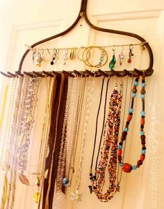 Jewelry organization has recently stepped up a notch. I've seen a lot of people DIY'ing unique storage solutions with the most fun materials you can imagine. Did you ever think a rake could be used as a jewelry organizer? Check it out at Sarahdipities. Looking for more DIY options for jewelry organization? Click through the jump to see them!