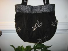 closer view of Evette's horsie purse