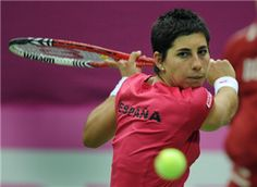Spanish Carla Suarez Navarro returns a ball to Russia's Nadia Petrova in Moscow on February 5, 2012 during their Fed Cup tennis World Group first round match. Suarez Navarro defaated Petrova 6-0, 6-3.