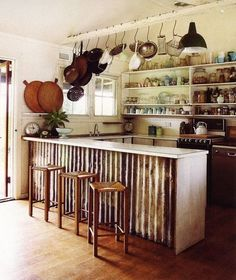 kitchen, dining, corrugated metal bar, bar stools, hanging pot rack, wall shelf, open shelving, rustic.