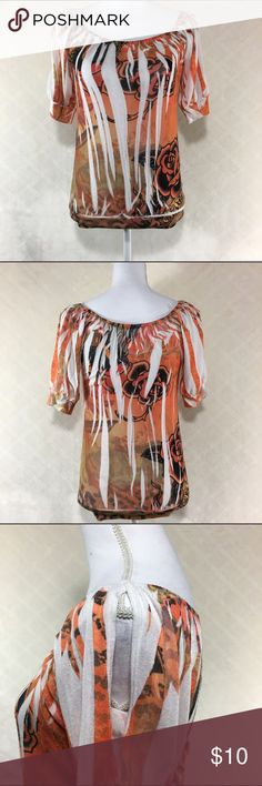 🐘 Orange flowered open sleeve top Orange flowered open sleeve top. Banded bottom. 3/4 length top. Charlotte Russe I think it is a small. Materials tag cut out. A few small snags, shown in last picture. Charlotte Russe Tops