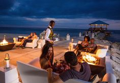 Over the sea or on land, the staff at the brand new Latitudes bar offer impeccable service fit to your liking | Sandals Resorts | Jamaica