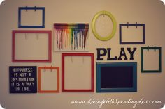 Clothespins on frames to hang children's artwork- love this idea!