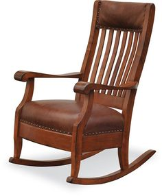 Amish Upholstered Grandma's Rocker with Optional Footstool - This Amish handcrafted solid wood rocking chair will being back memories of the one you remember at your Grandma's house! This Rocker is recognized for its comfort! It is one of our most popular designs and goes well with a variety of styles and decors. Add the optional footstool to enhance your relaxation.
