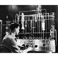 Side profile of an engineer operating Vacuum Fusion Gas Analyzer in a laboratory Canvas Art - (18 x 24)
