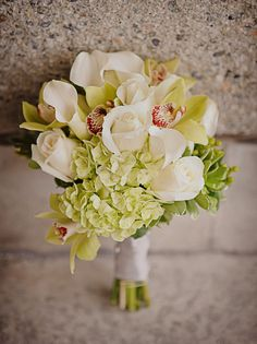 green and white bouquet with roses, hydrangeas, orchids