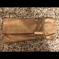 Gold Jimmy Choo Clutch - Soft Leather, Authentic I only used ones in a wedding.. It's in great condition! Jimmy Choo Bags Clutches & Wristlets