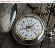 He encontrado este interesante anuncio de Etsy en https://www.etsy.com/es/listing/187589885/on-sale-rare-antique-pocket-watch-dent