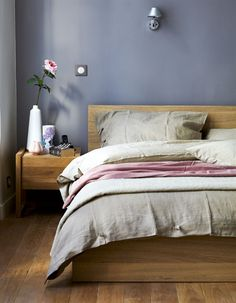Wooden bedroom furniture in warm and natural home.