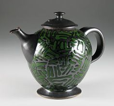 Steve Irvine Pottery - This teapot has a black iron glaze with a green trailed glaze pattern over the top.