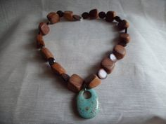 Turquoise pendant and wood beaded necklace by VintageLover818, $18.50