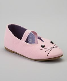 Little ladies feel especially ladylike when skipping down the sidewalk in these charming flats. A smooth, velvet-like finish, timeless silhouette and cheeky kitten toe detail ensure they pair as prettily with tea party dresses as denim, while an elastic strap closure makes them extra secure.