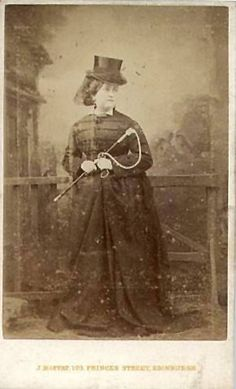 Carte De Visite from C.1861-1865. Note the military influence on the bodice of the habit with all the decorative frogging across it. This was a popular fashion for riding habits for most of the 19th century up until the 1870's. Note also how long her skirt is