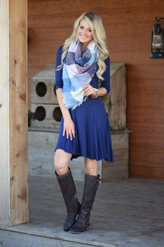 "Pairs perfectly with a scarf, or other accessories for the perfect ""early fall"" look. Running pretty true to size, & the dress does have a stretchy material. Tapers in at the waist then flares back ou"