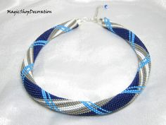 Necklace Sea Breeze bead crochet. Unique handmade jewelry. Summer fashionable and beautiful colors of blue, gray and white. Decorative accessories complemented by silver.  In memory of the sunny days and gentle sea, and I made this necklace. Hopefully it will warm you for a long time.  Necklace length is 16,5-18,9 inches (42-48 cm). Made by hand, the ends of imitation silver. Made with love.