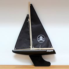 """Iconic outdoor toy promoting traditional outdoor play. The Skipper 12"""" pond yacht has a skull and cross bones sail design. Free delivery."""