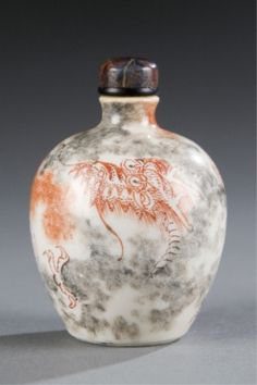 Lot 488: A Chinese porcelain snuff bottle with red dragon and flaming pearl in clouds. c.1800-1880. Estimate: $400-$600.